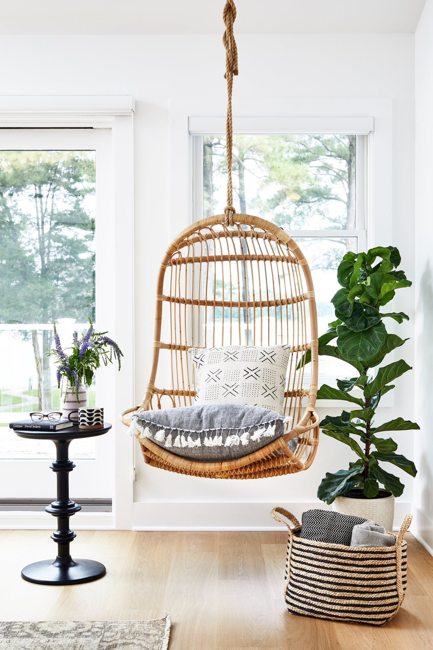 Stylish Boho Egg Chair - Image via Zoe Feldman Design, Photography by Stacy Zarin Goldberg feat. Hanging Rattan Chair from Serena and Lily.