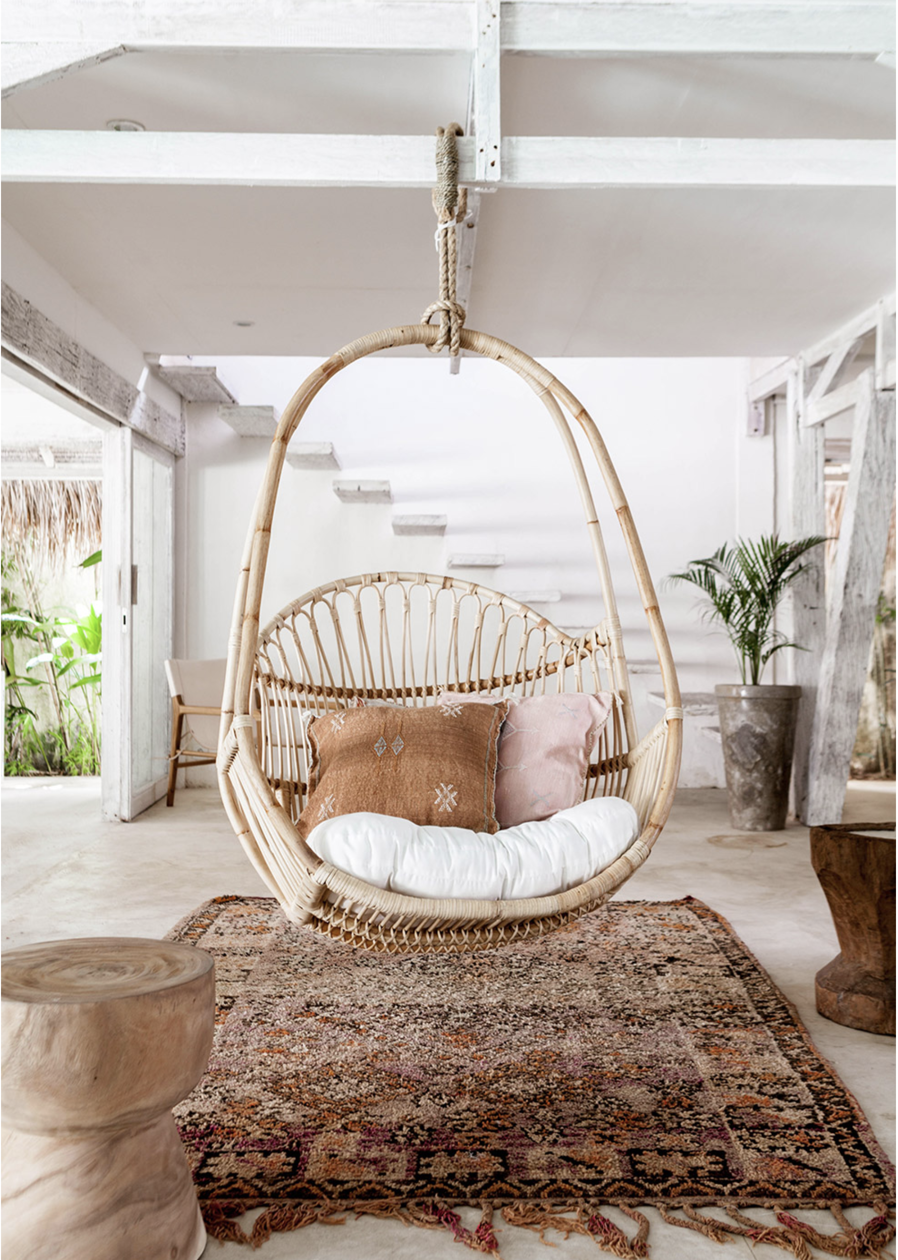 Stylish Boho egg chairs - Image via Bali Interiors feat. Kenya Hanging Chair from Yak + Yeti Trader.