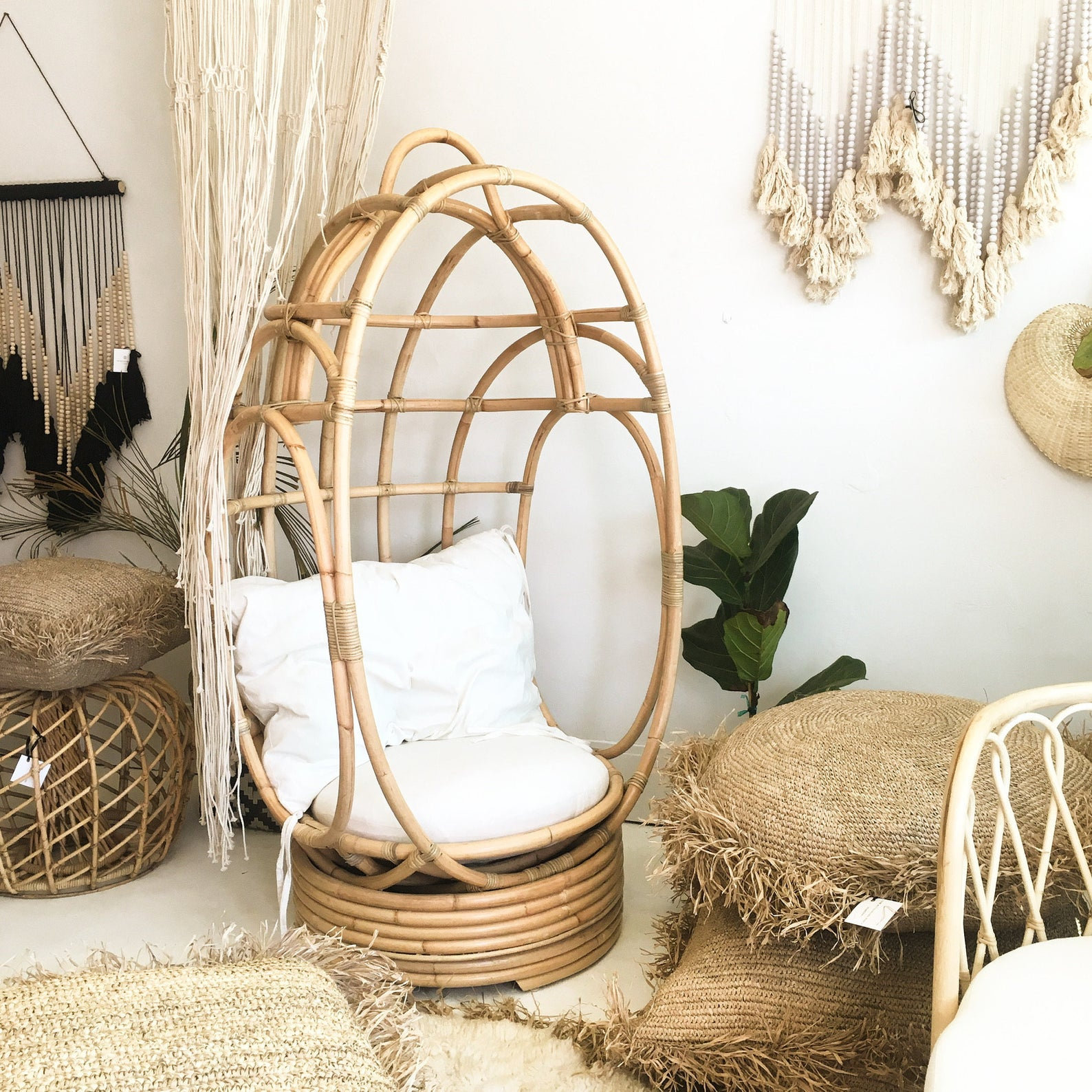 Stylish Boho egg chairs - Image via The Wicked Boheme (Etsy) feat. Vintage Style Rattan Swivel Egg Chair.