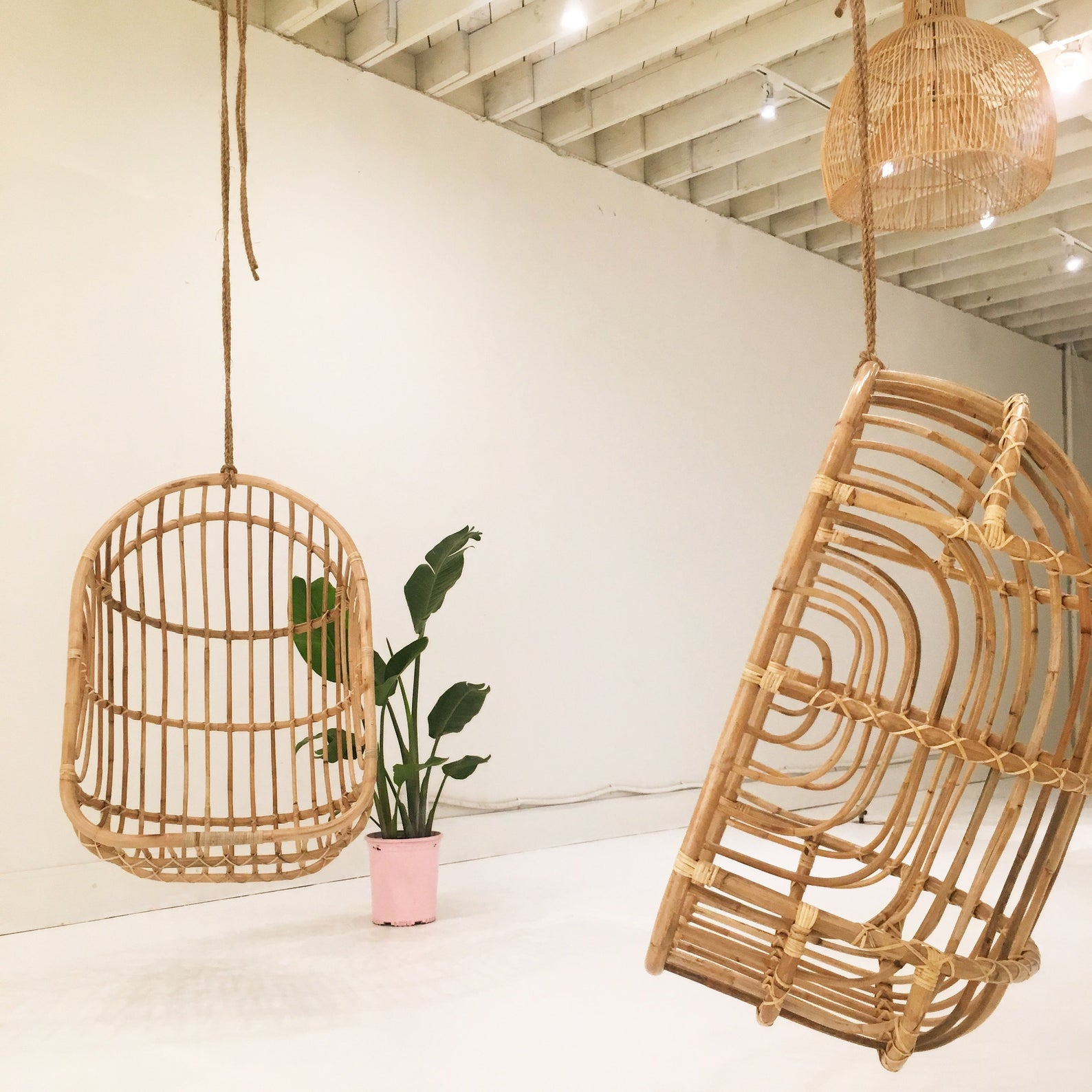 Stylish Boho egg chairs - Image via The Wicked Boheme (Etsy) feat. Nest Rattan Hanging Chair.