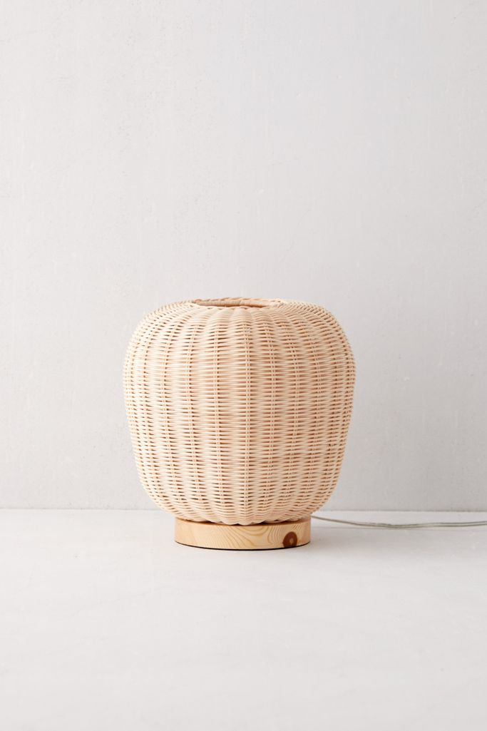 Rattan table lamp from Urban Outfitters. Stylish Boho Bedside Lamps and Lighting Options.