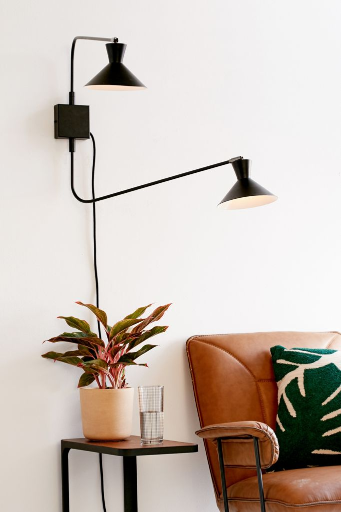 Black double swing arm wall sconce from Urban Outfitters. Stylish Boho Bedside Lamps and Lighting Options.