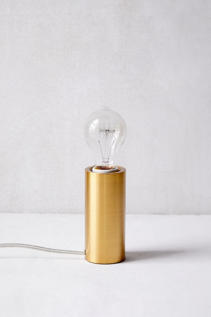 Gold cylinder metal table lamp from Urban Outfitters.