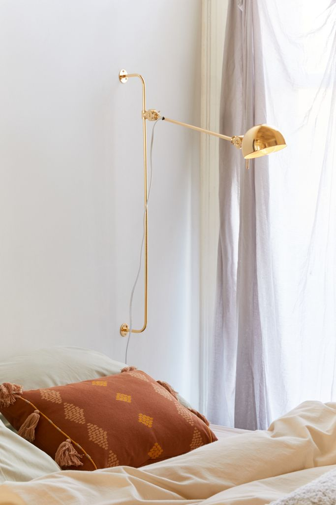 Gold adjustable swing arm wall sconce from Urban Outfitters.