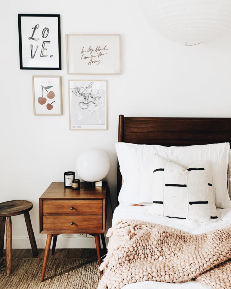 Bohemian bedroom with Mid-Century modern nightstand, wall art and globe bedside lamp, IMAGE: via @genevavanderzeil on Instagram.