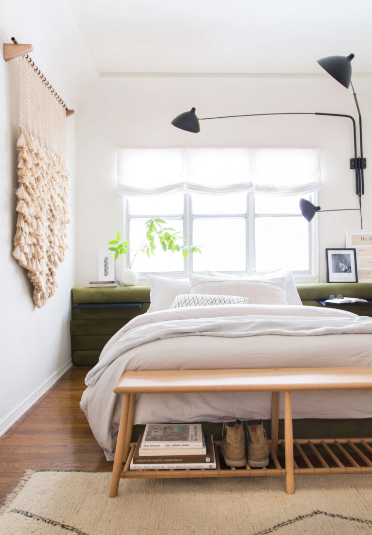 Light and airy modern Bohemian bedroom with green velvet headboard and black swing arm wall sconce lights, IMAGE: via Style by Emily Henderson, photography by Tessa Neustadt. Stylish Boho Bedside Lamps and Lighting Options.