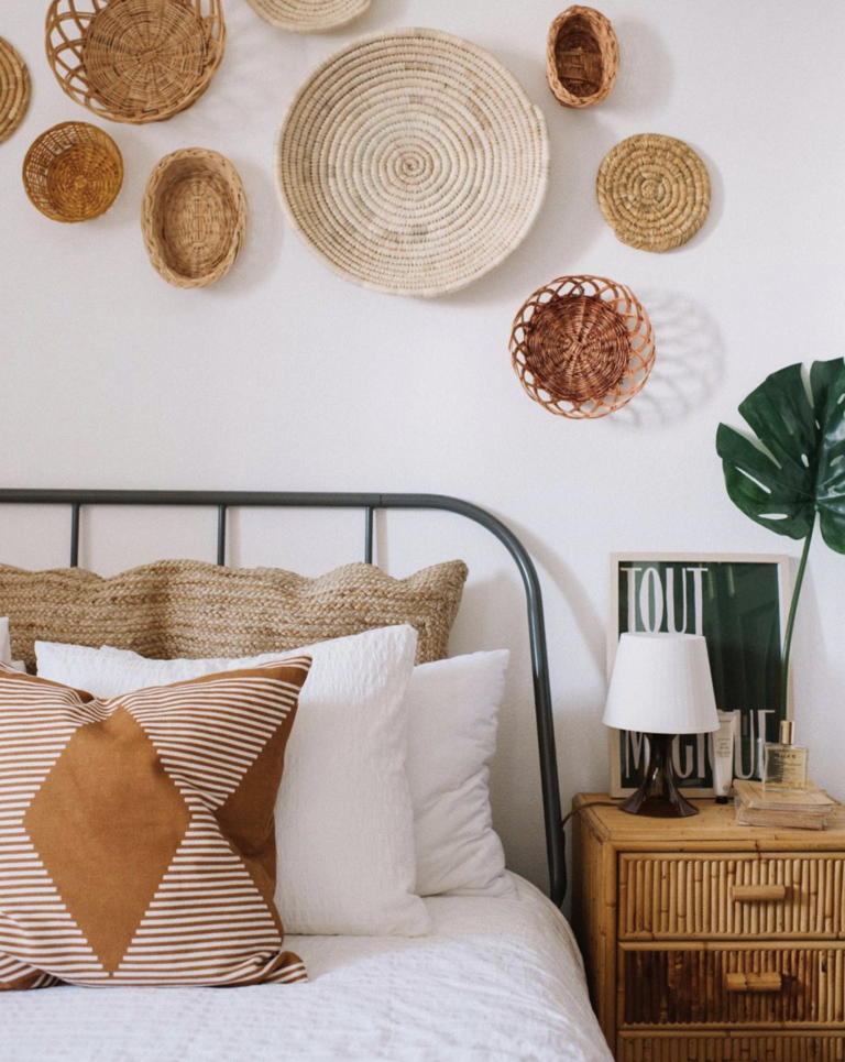 Boho-Chic bedroom with textural round wall art and mudcloth pillows, IMAGE: via @emilyjanelathan on Instagram, photography by @genevavanderzeil.