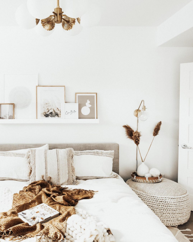 Simple white modern Bohemian-Chic bedroom with gold/brass wall sconce, IMAGE: via @amyepeters on Instagram, feat. @mymitzi sconces. Stylish Boho Bedside Lamps and Lighting Options.