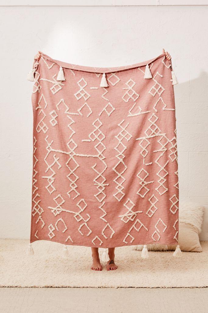 Dusty Pink Tufted Geo Tassel Throw Blanket via Urban Outfitters.