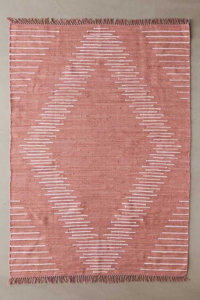 Dusty Pink Woven Rug via Urban Outfitters.
