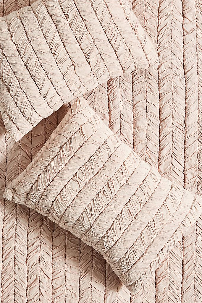Dusty Pink Ruched Pillow Shams via Anthropologie.