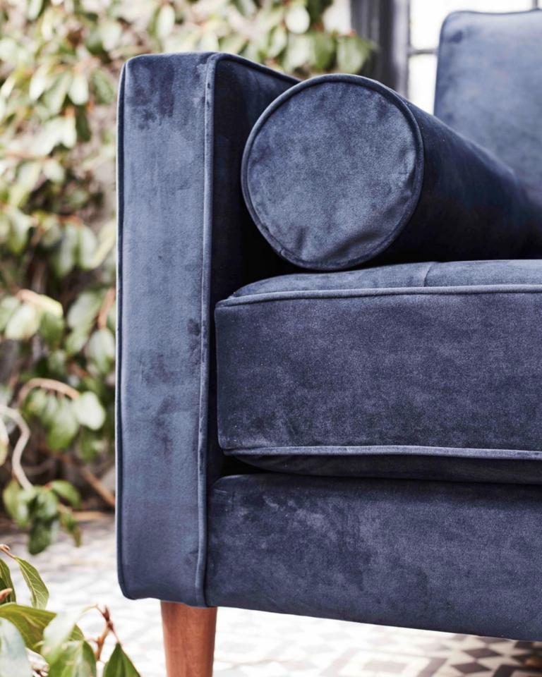 33 Navy Blue Velvet Sectional Sofas You'll Love - feature image via @apt2b on Instagram, feat. Sampson Sofa in Eclipse Velvet, photography by @treasurbite.
