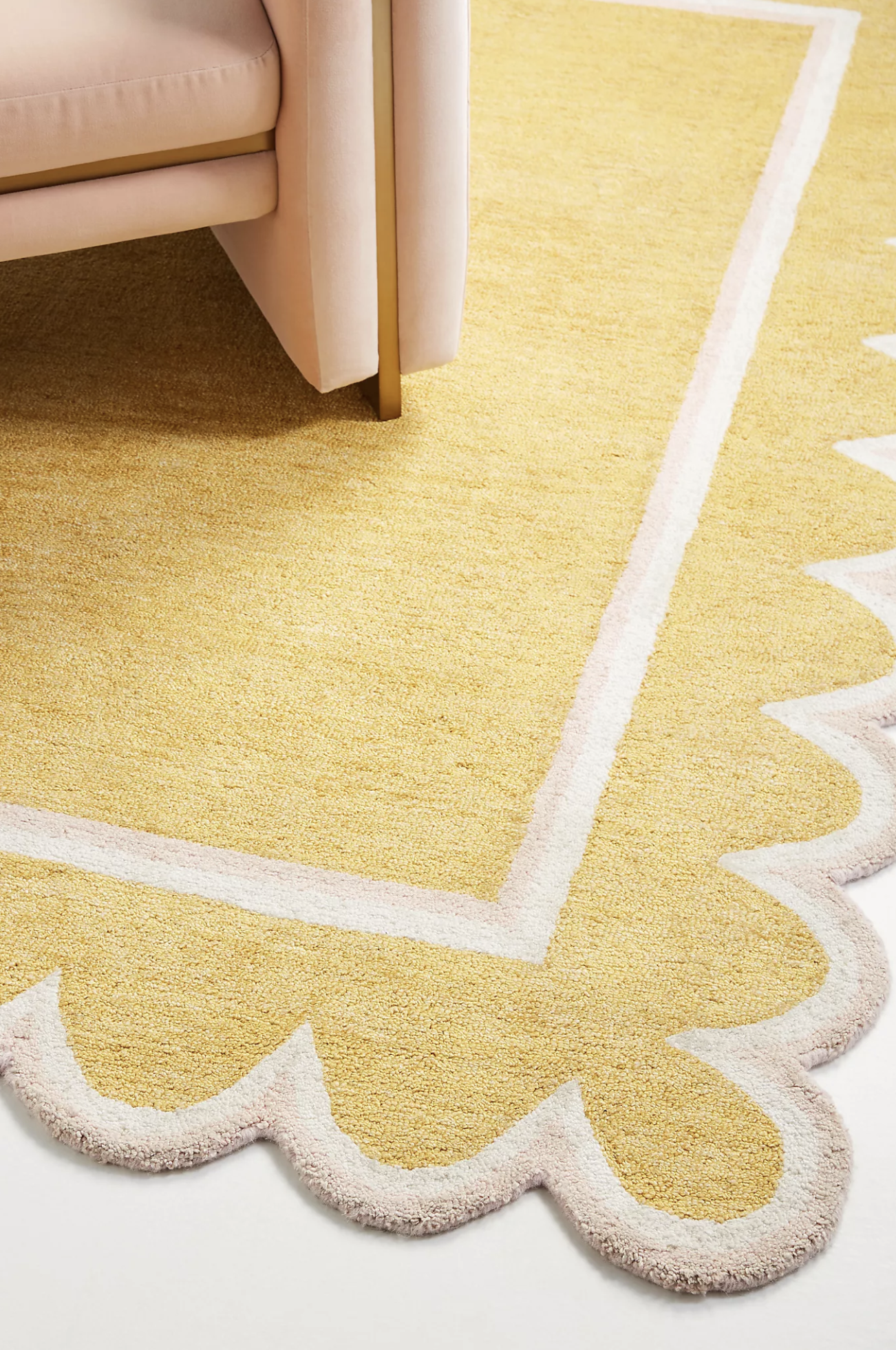21 Stylish 8'x10' Mid-Century Modern Rugs feat. Hand-Tufted Scallop Rug – Maize via Anthropologie
