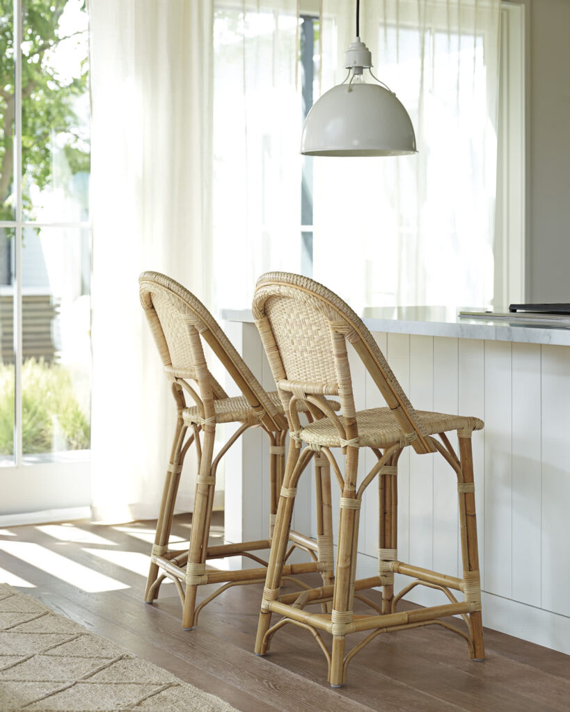 10 Stylish Modern Rattan Counter Stools with Backs - feat. Sunwashed Riviera Counter Stool in Natural from Serena & Lily, Image via Serena & Lily.