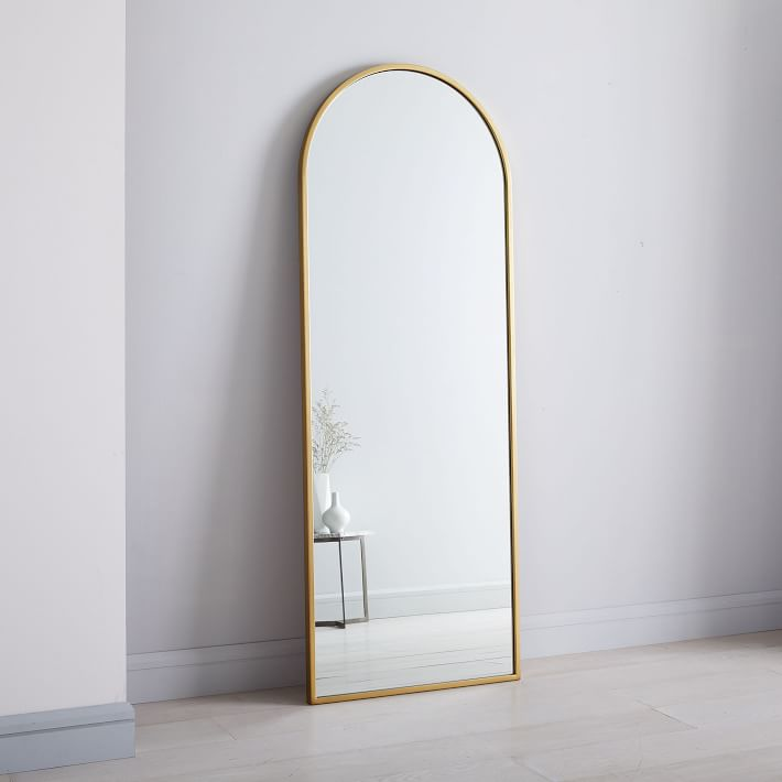 20+ Stylish Full Length Arched Mirror Options You'll Love - image via Urban Outfitters, feat. 'Emelie Floor Mirror'