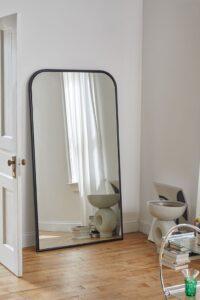 image via Urban Outfitters, feat. 'Selene Floor Mirror'