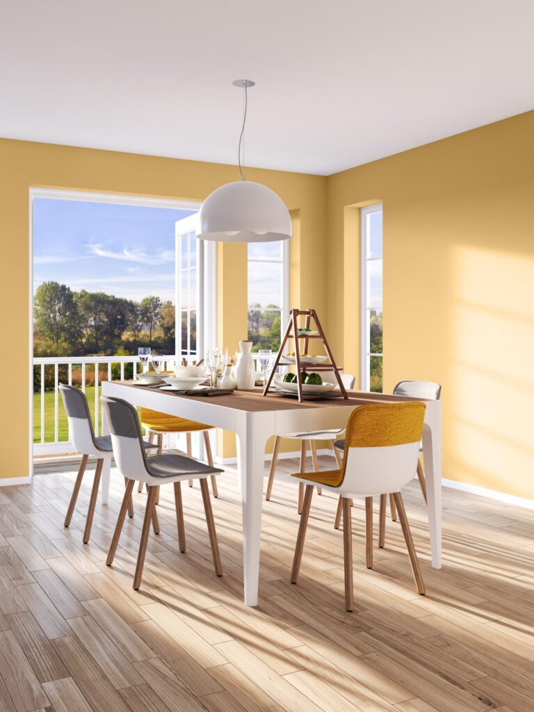 30+ Inspiring Yellow Wall Paint Combinations (With Color Names) - feat. 'Charismatic PPU6-14' from Behr Paint, yellow dining room, IMAGE: via Behr