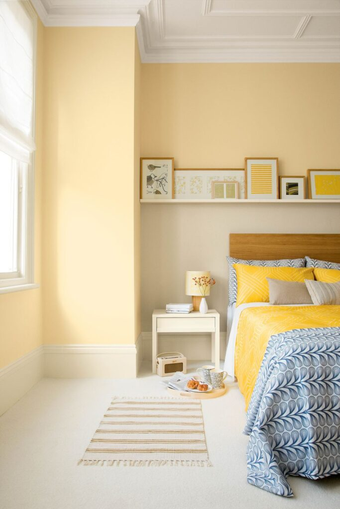30+ Inspiring Yellow Wall Paint Combinations (With Color Names), yellow bedroom, - feat. COLOR: 'Breatheasy Sunrise' from Crown Paints, IMAGE: via House Beautiful