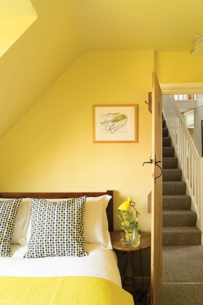 30+ Inspiring Yellow Wall Paint Combinations (With Color Names) - feat. 'Ciara Yellow No.73′ from Farrow & Ball, yellow bedroom, IMAGE: via House Beautiful