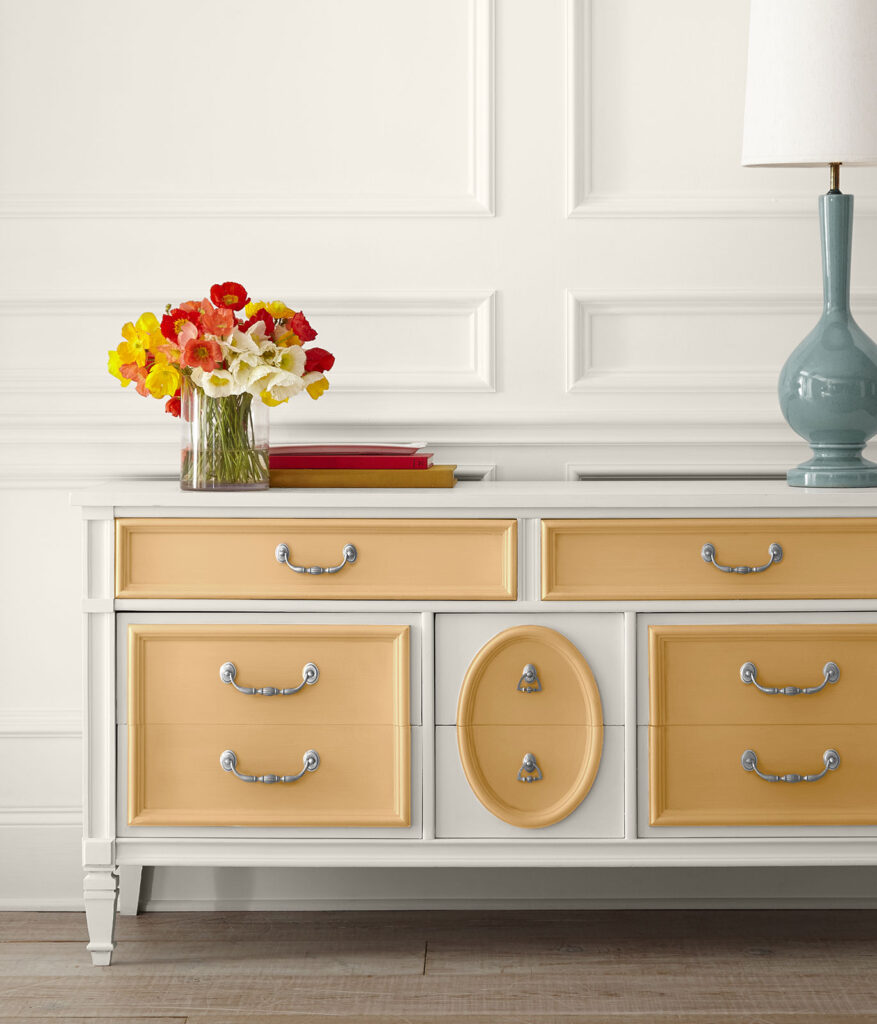 30+ Inspiring Yellow Wall Paint Combinations (With Color Names) - feat. 'Cellini Gold HDC-CL-18' from Behr Paint, IMAGE: via Behr, painted yellow dresser