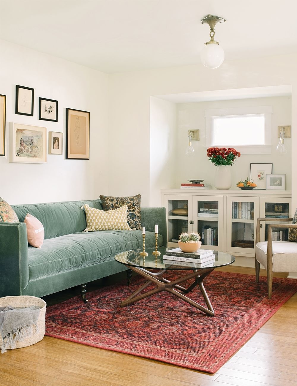14+ Beautiful Sage Green Velvet Sofa Options - IMAGE via Lulu and Georgia feat. 'Fabienne' Sofa in Moss, Design: Ginny Macdonald, Photography: Lauren Pressey