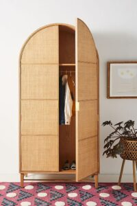 ROUND-UP: 11 Chic Woven and Rattan Wardrobes and Armoires - image via Anthropologie, feat. 'Wallace Cane and Oak Armoire'