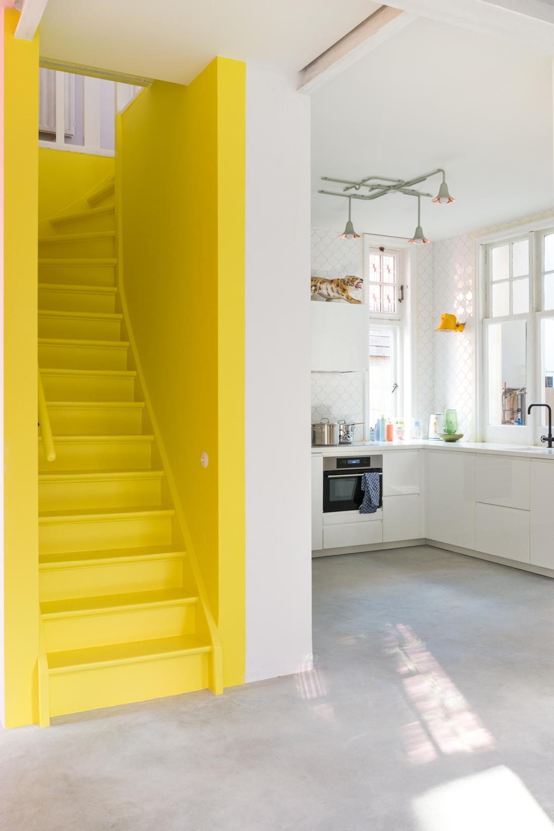 IMAGE: via Anki Wijnen, Zilverblauw. Yellow staircase, concrete floors