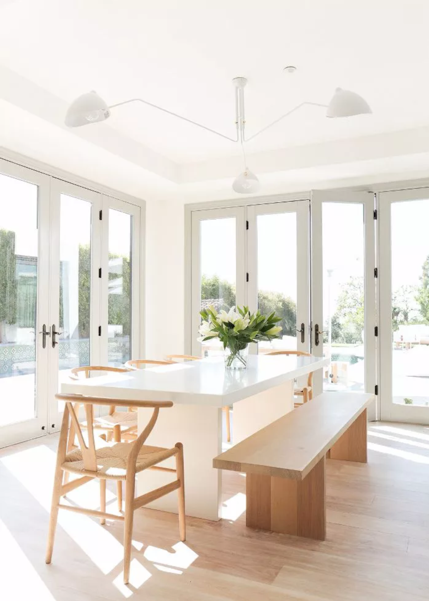 Best Warm White Paint Colors - Farrow and Ball - IMAGE: by Tessa Neustadt, Design: Alexander Design via MyDomaine feat. paint color 'Ammonite' from Farrow and Ball