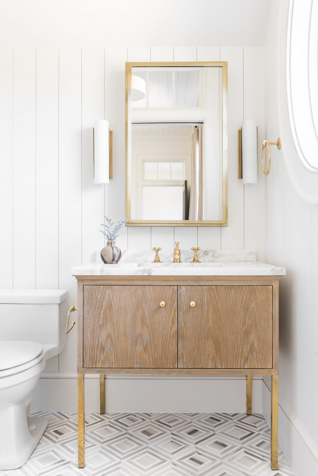 Best Warm White Paint Colors - Benjamin Moore - IMAGE: Design: Cortney Bishop, Photo: Katie Charlotte via MyDomaine feat. paint color 'White Dove' from Benjamin Moore