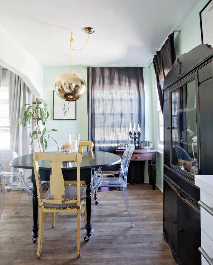Image by Lindsey Kay Averill via Apartment Therapy, mint green walls in an eclectic dining room.