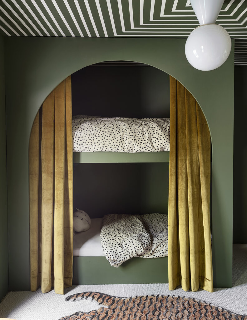 Image via Sarah Sherman Samuel, forest green bunk beds with velvet mustard yellow curtains, spotty duvets, Mid-Century Modern style kids bedroom.