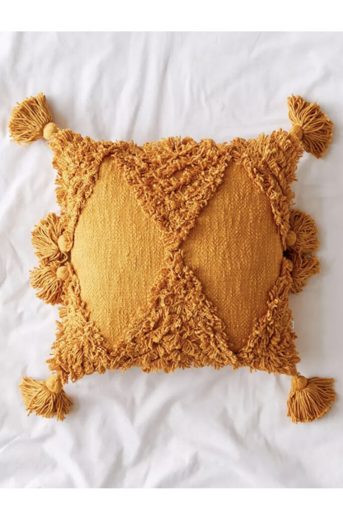 Mustard Tassel Cushion via UO