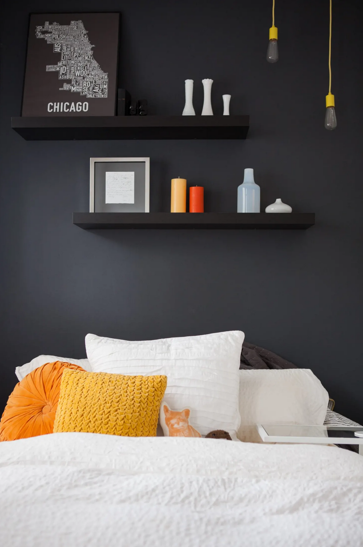 Best Navy and Mustard Bedroom Ideas - Image via Apartment Therapy, photo by Brittany Purlee, wall color by Behr in shade 'Deep Space'