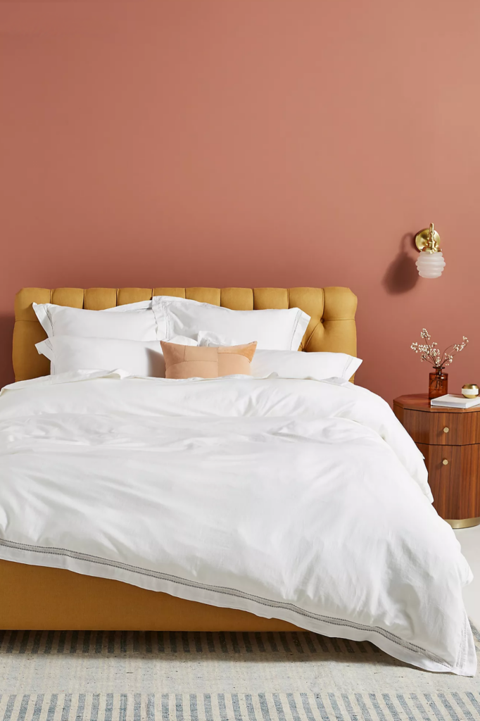 EARTH TONES: Terracotta Bedroom Ideas and Paint Colors - Image via Anthropologie