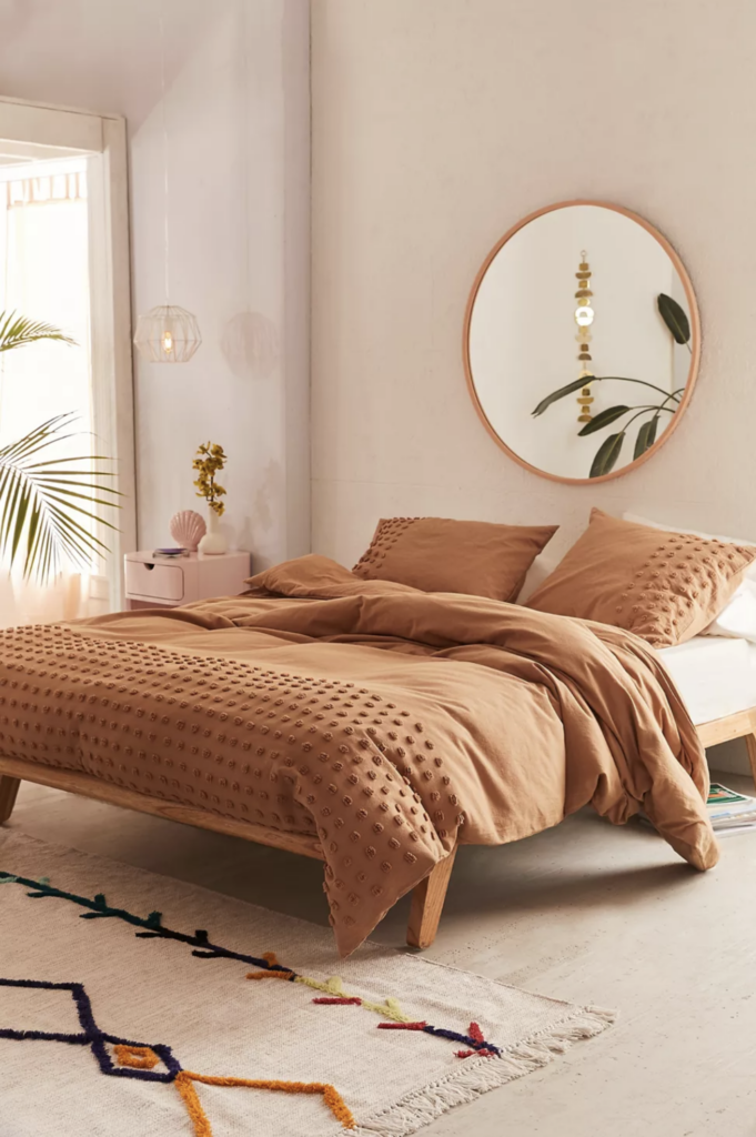 EARTH TONES: Terracotta Bedroom Ideas and Paint Colors - Image via Urban Outfitters
