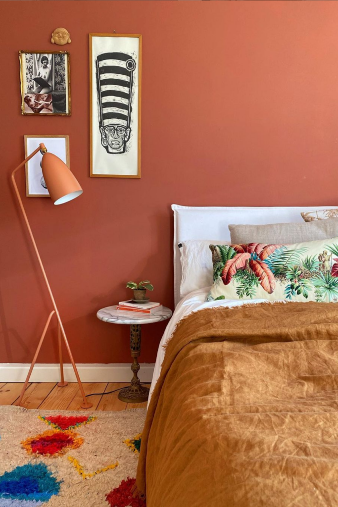 Earth Tones: Terracotta Bedroom Ideas and Paint Colors - Image via @nikogwendo, feat. paint color 'Book Room Red' by Farrow & Ball