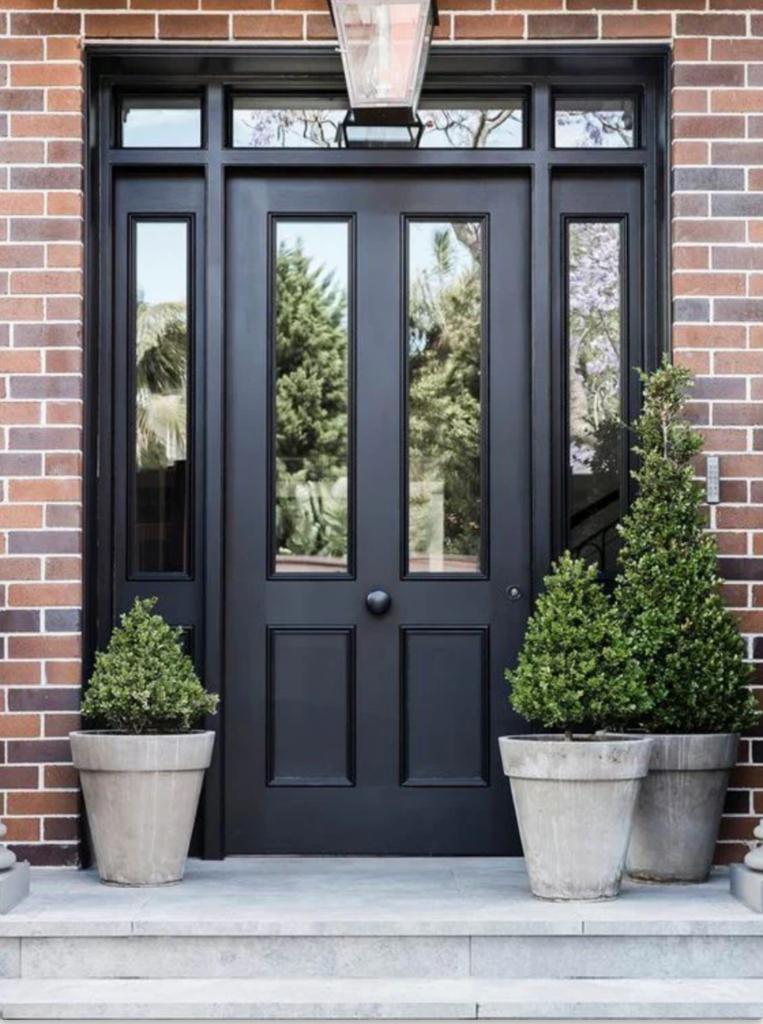 10 Popular Front Door Colors for Brick Houses - Image via Brick and Batten, black door