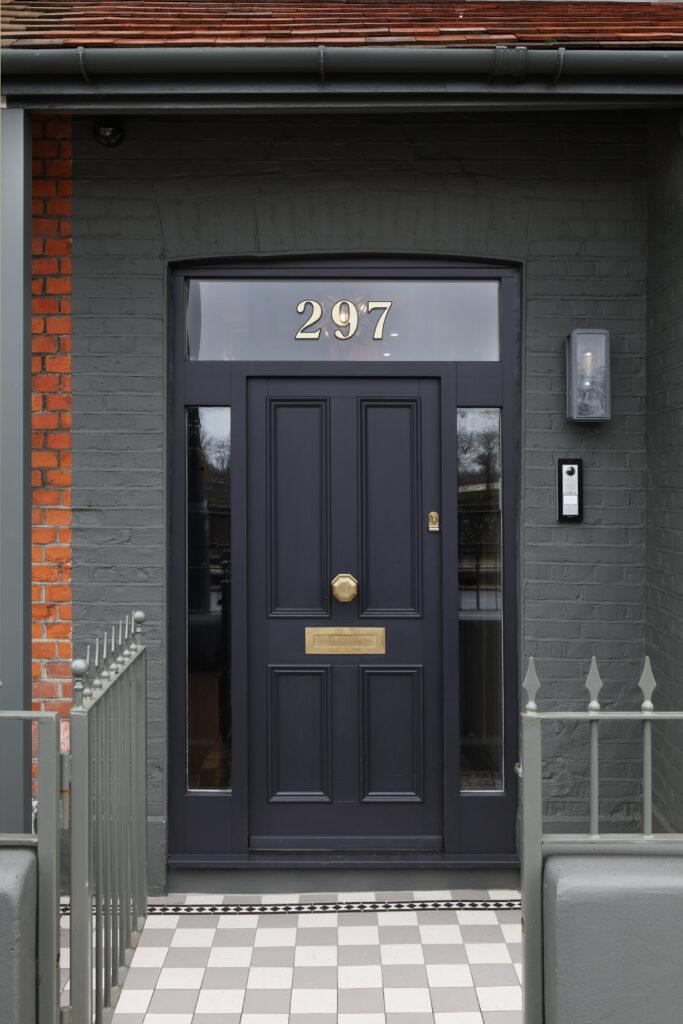 10 Popular Front Door Colors for Brick Houses - Image via Ham Interiors, black door