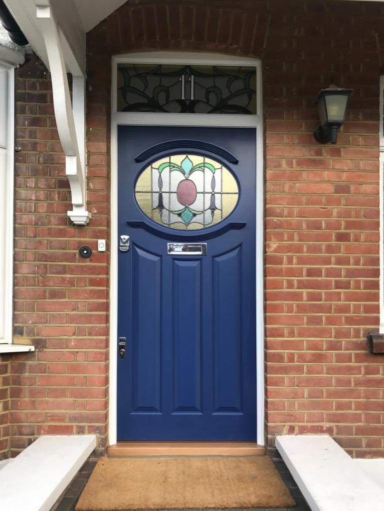 10 Popular Front Door Colors for Brick Houses - Image via The Bespoke Front Door blog, blue door