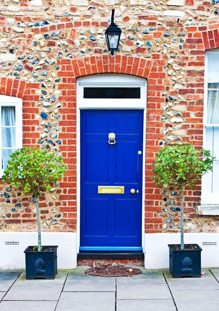 Image via Good Housekeeping, blue door