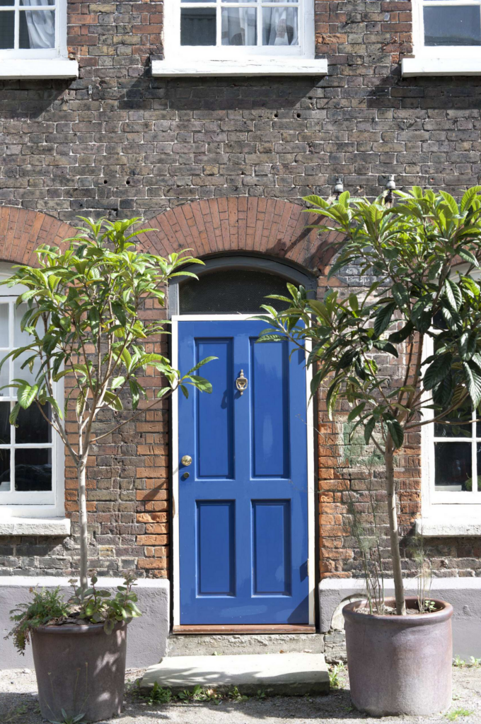 Image via Houzz, by Designerpaint feat. paint color: 'Drawing Room Blue' by Farrow & Ball, blue door