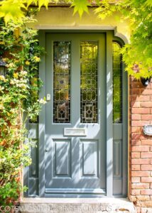 10 Popular Front Door Colors for Brick Houses - Image via Cottwoods Door Specialists Limited, blue-gray door