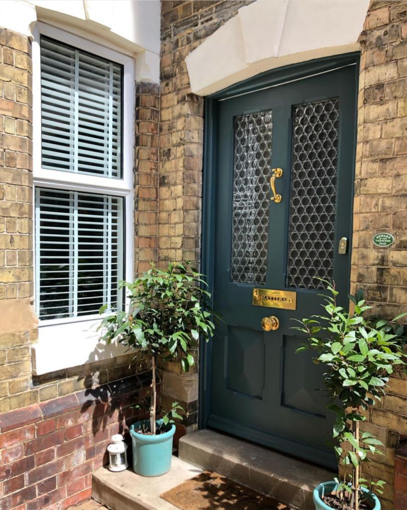 Image via @trinityvilla_reno, green door