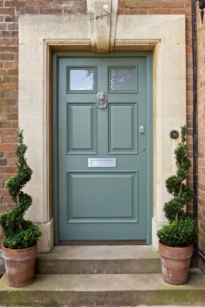 10 Popular Front Door Colors for Brick Houses - Image via Houzz by Designerpaint, in paint color: 'Card Room Green' by Farrow & Ball, green door