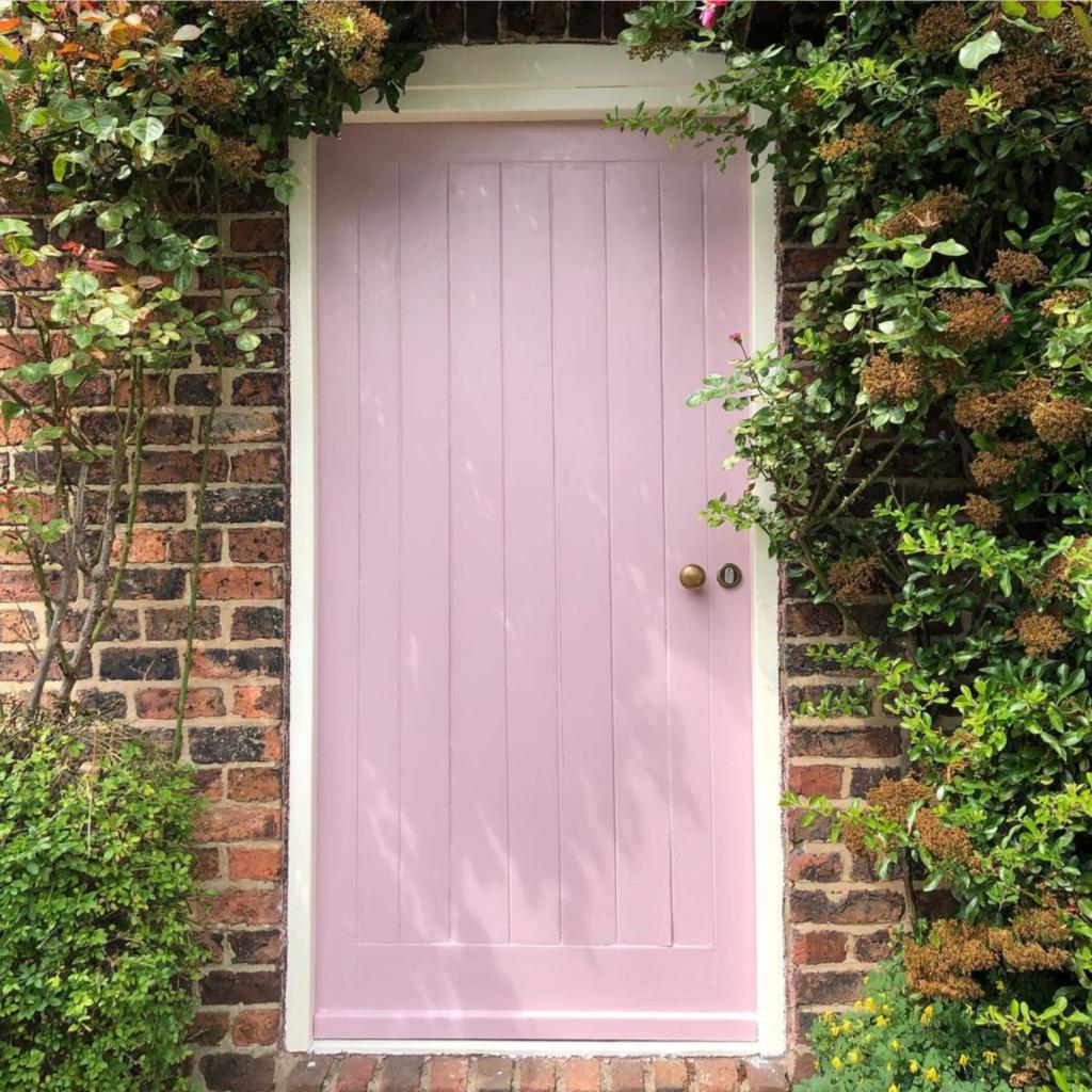 10 Popular Front Door Colors for Brick Houses - Image via @georgianhouseproject feat. paint color: 'Cinder Rose' by Farrow & Ball, pink door