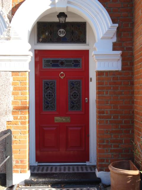 Image via The Bespoke Front Door blog, red door