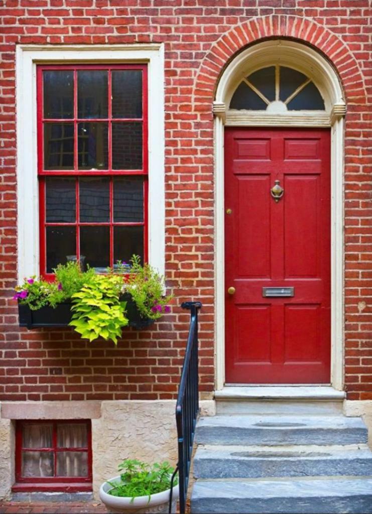 Image via Houzz by Designerpaint, red door
