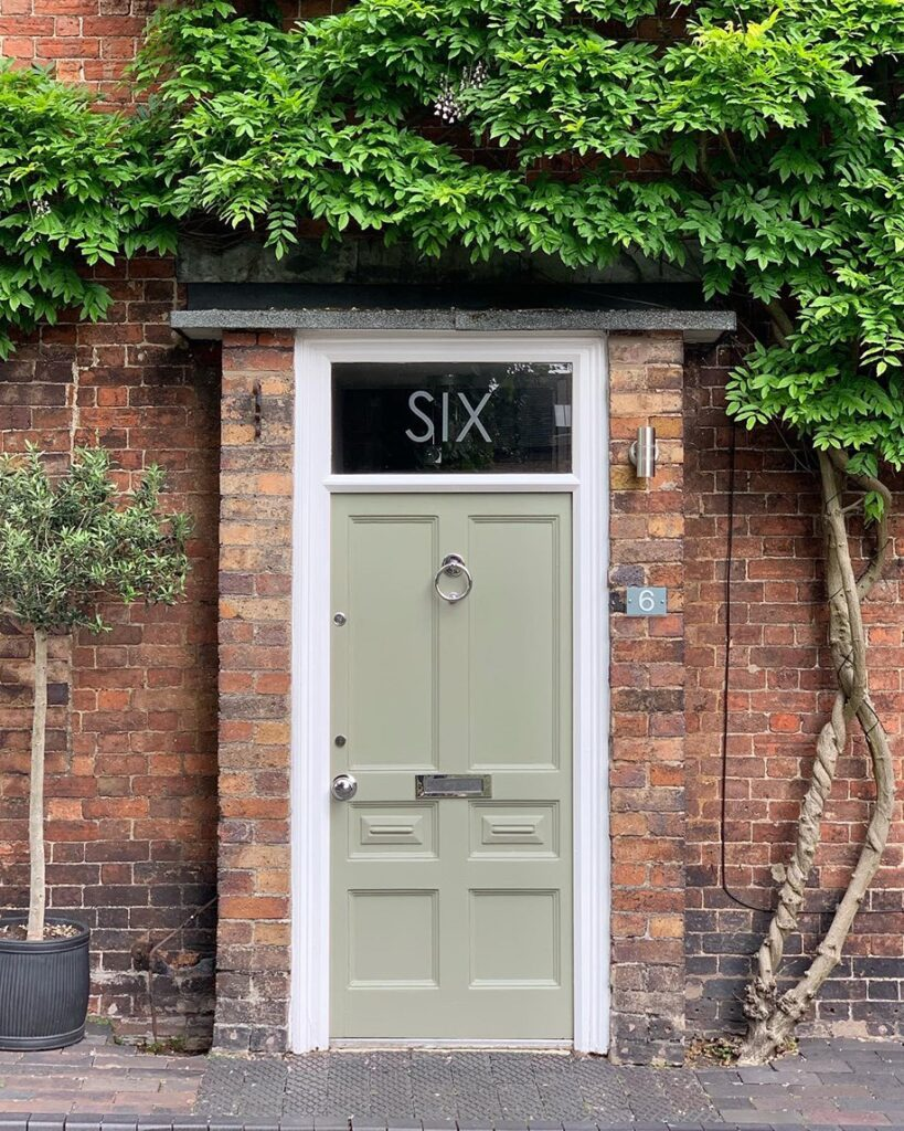Image via @cherrywoodhouse feat. paint color: 'Treron' by Farrow & Ball, sage green door