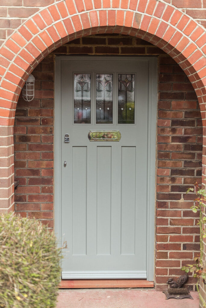 Image via Fifi McGee, sage green door