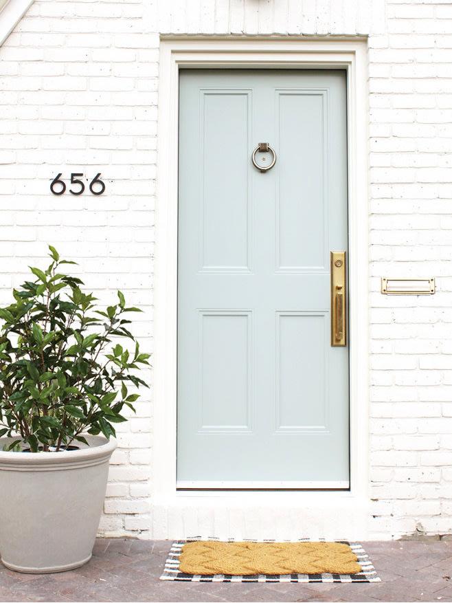 Image via Domino, photo by Callie Hobbs, sage green door
